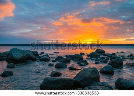 Stones in Baltic sea at sunrise. Beautiful dawn in Lahemaa Netional park, Estonia - stock photo