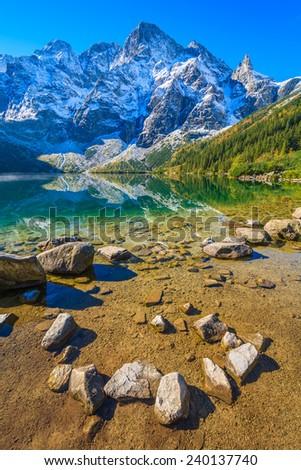 Stones in Morskie Oko lake in autumn season, Tatra Mountains, Poland - stock photo
