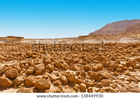 Stones in the Judean Desert on the West Bank of the Jordan River - stock photo