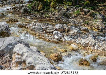 Stones in the mountain river - stock photo