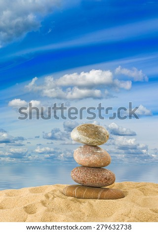 stones in the sand against the water - stock photo