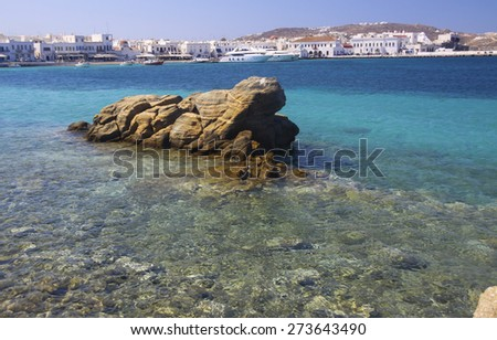 Stones in the sea with rock and bottom Mykonos Town, Greece - stock photo