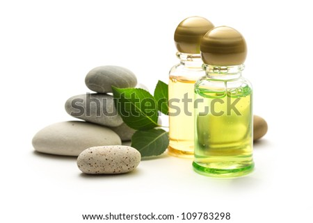 Stones, leaves and shampoo bottles - stock photo