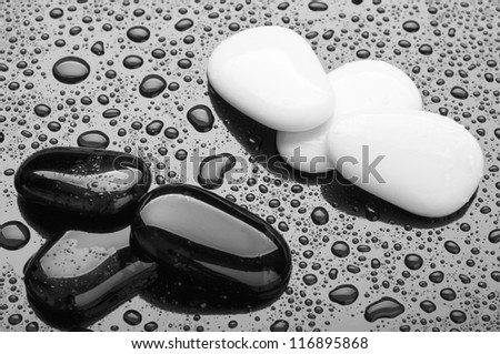 stones of black and white pebbles with water drops. abstract background, spa - stock photo