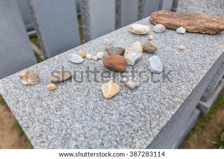 Stones on a Jewish grave - stock photo