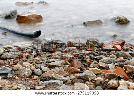 Stones on the bank of the river Neva - stock photo