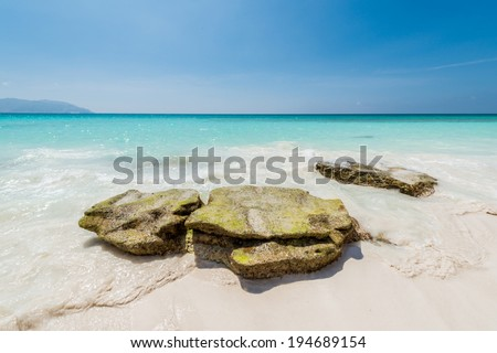 Stones on the calm coast of the ocean