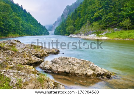 Stones on the riverbank in the mountains. The Dunajec River Gorge, Pieniny. Poland and Slovakia national border. - stock photo
