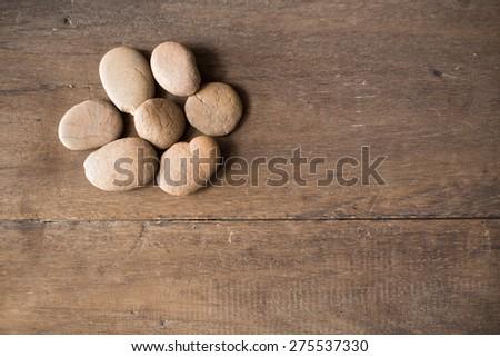 stones on wood - stock photo