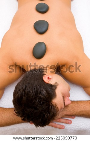 stones placed of a young man - stock photo