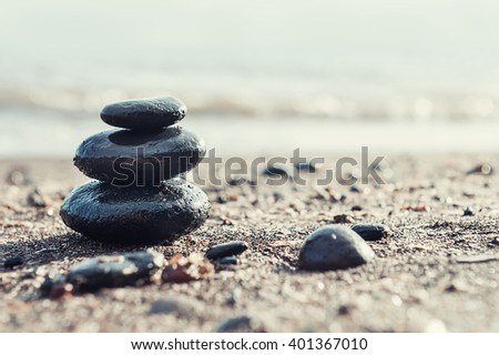 Stones pyramid on the beach. Selective focus.