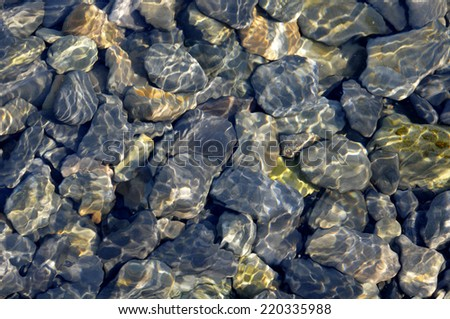 Stones under water. Background. - stock photo