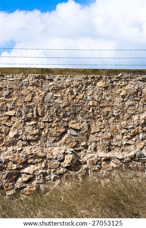 stones wall against cloudy sky - stock photo