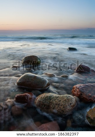 Stony beach after sunset