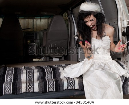 Stood up angry bride screaming at her phone - stock photo