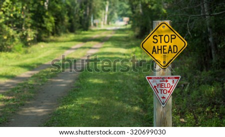 Stop Ahead and Yield sign at a recreation trail for hiking, biking, horseback riding, and in the winter snowmobiling.