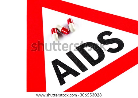 Stop AIDS and HIV, capsule with Warning Sign Social Issues - stock photo