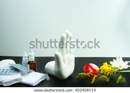 Stop allergy concept, seasonal pollen and blossom allergy, medication and tissues, copy space - stock photo