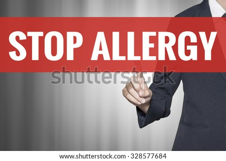 Stop Allergy word on virtual screen push by business woman red tab - stock photo
