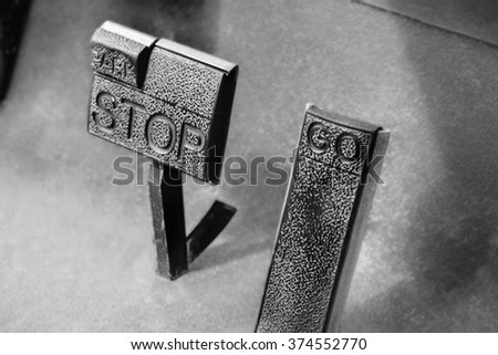 Stop and Go pad in black and white color, concept for leader decision making, go or no go - stock photo