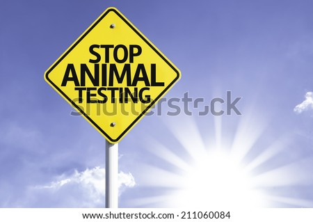 Stop Animal Testing road sign with sun background  - stock photo