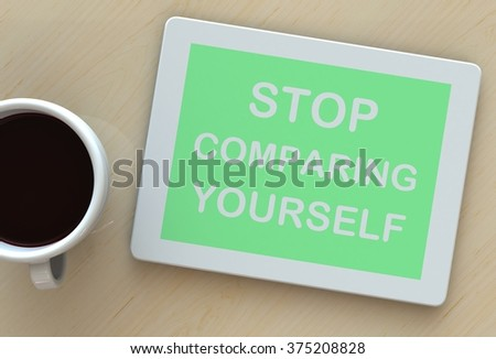 STOP COMPARING YOURSELF, message on tablet and coffee on table - stock photo