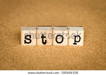 Stop Concept, Alphabet stamp on a cork board