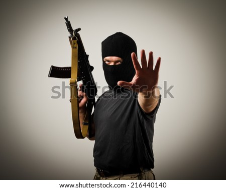 Stop concept. Gunman showing stop signal by hand. - stock photo