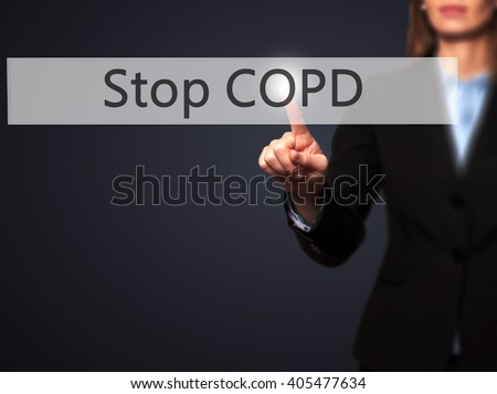 Stop COPD - Businesswoman hand pressing button on touch screen interface. Business, technology, internet concept. Stock Photo - stock photo