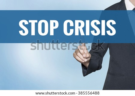 Stop Crisis word on virtual screen touch by business woman blue background - stock photo