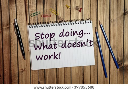 Stop doing what doesn't work text written on notebook - stock photo