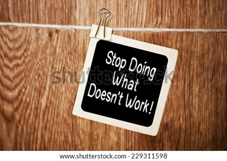 Stop Doing What Doesn't Work! written on a chalkboard - stock photo