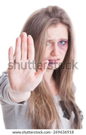 Stop domestic violence against women concept with an abused injured and bruised woman on white background - stock photo