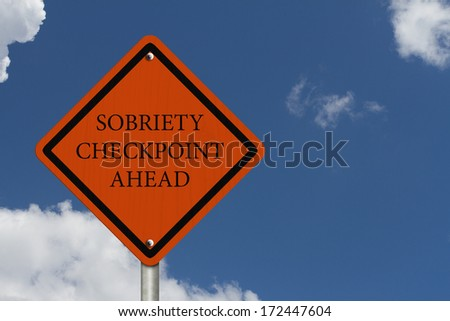 Stop Drinking and Driving, An American road warning sign with words Sobriety Checkpoint Ahead with blue sky