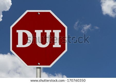 Stop Drinking and Driving Sign, An American road sign and words DUI with blue sky - stock photo