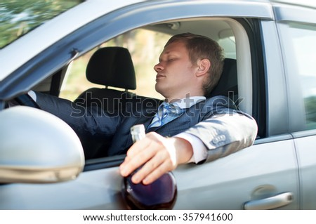 Stop drunk driver fell asleep at the wheel - stock photo