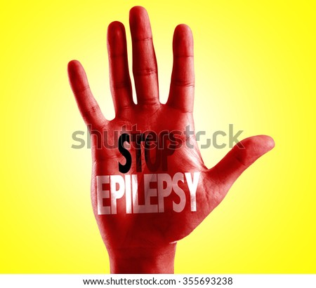 Stop Epilepsy written on hand with yellow background - stock photo