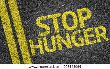 Stop Hunger written on the road - stock photo