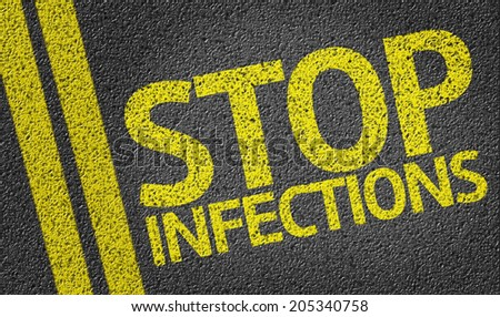 Stop Infections written on the road - stock photo