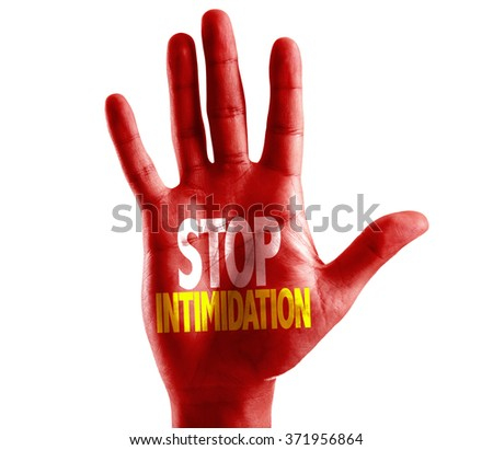 Stop Intimidation written on hand isolated on white background - stock photo