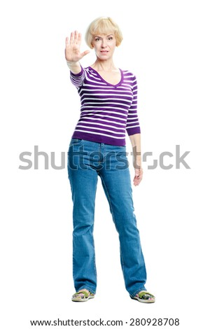 Stop it! Full length portrait of confident middle aged woman showing her palm. Isolated on white. - stock photo