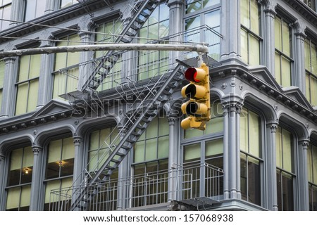 Stop light and historic cast iron buildings in New York City's Soho District - stock photo