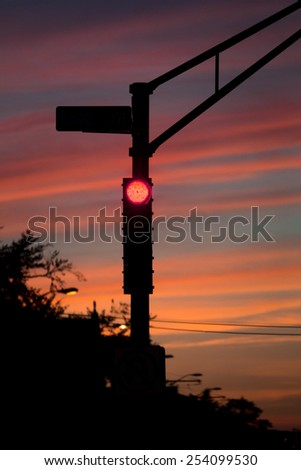 Stop light in Cambridge, Massachusetts at dusk. - stock photo