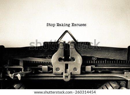 Stop making excuses written on vintage typewriter - stock photo