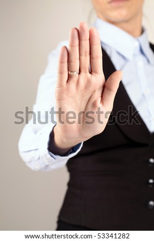 Stop. No. Sign showed by Woman hand.
