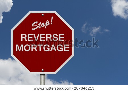 Stop Reverse Mortgage Road Sign, Stop sign with words Reverse Mortgage with sky background