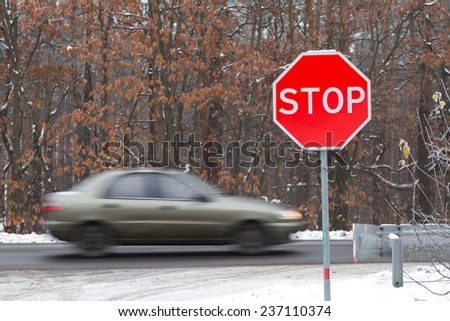 Stop road sign on a highway with traffic cars - stock photo