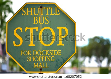 Stop road sign on a traffic - Shuttle Bus