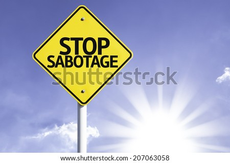 Stop Sabotage road sign with sun background  - stock photo