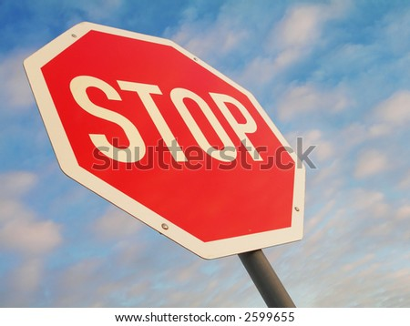 stop sign against blue light clouded sky - stock photo